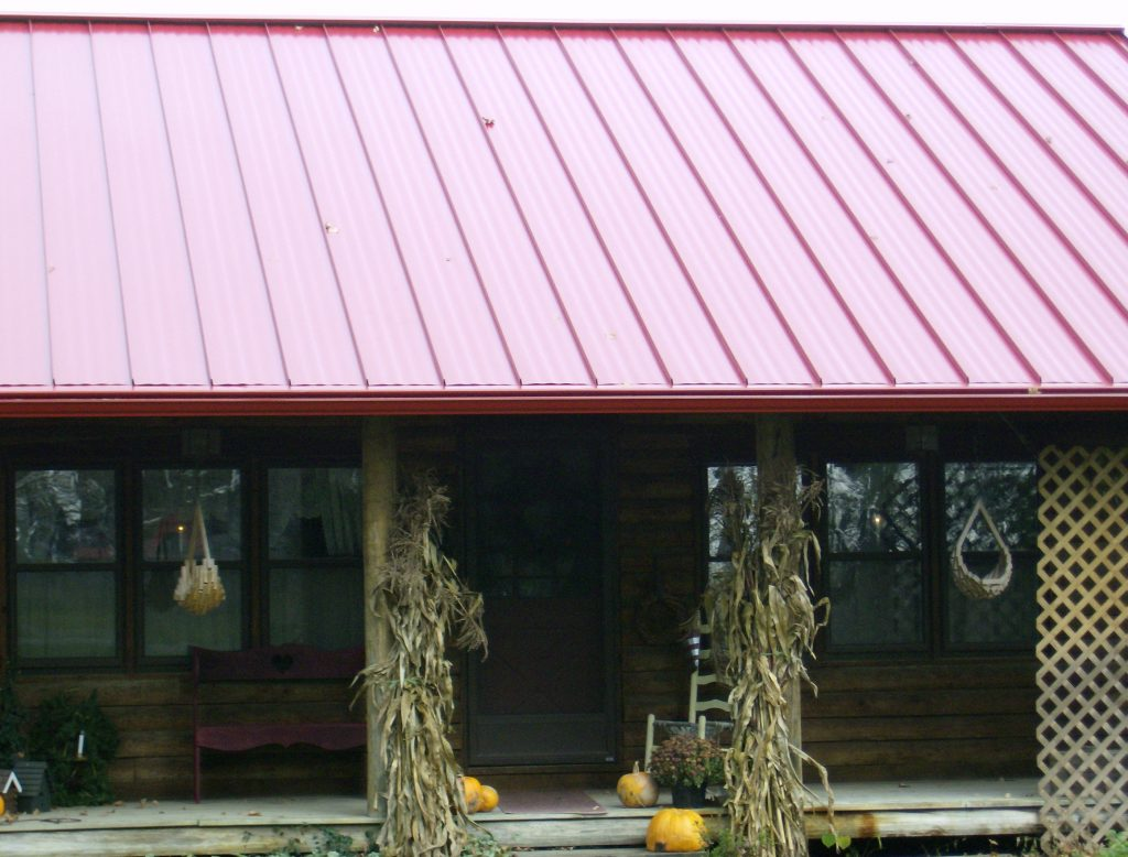 Red metal roof with guard